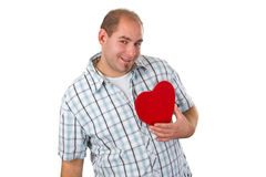 Young man holding red heart Stock Photography