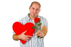 Young man holding red heart Royalty Free Stock Image
