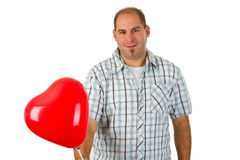 Young man holding red heart Stock Photos