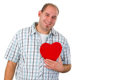 Young man holding red heart Stock Image