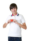 Young man holding red heart Royalty Free Stock Images