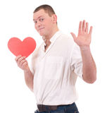 Young man holding red heart Royalty Free Stock Photography