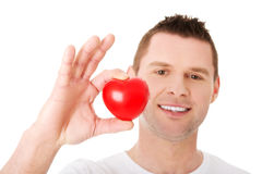Young man holding a red heart Stock Image