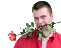 Young man holding a red rose Royalty Free Stock Images