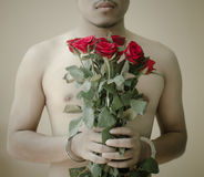 Young man holding red rose Stock Image