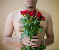 Young man holding red rose Stock Photography