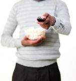 Young man holding remote control and pop corn Royalty Free Stock Image