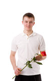 Young man holding rose Stock Images