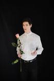 Young man holding rose and telephone Stock Images
