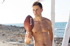 Young man holding a rugby ball Royalty Free Stock Images