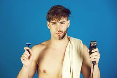 Free Young Man Holding Safety Razor And Electric Shaver Stock Image - 130559591