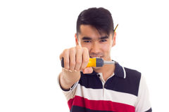 Young man holding a screwdriver Royalty Free Stock Photos