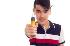 Young man holding a screwdriver Royalty Free Stock Photography