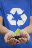 Young Man Holding Seedling in his Hands, Recycling Symbol, Close Up Stock Photography