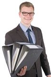 Young man is holding several files Stock Photos