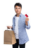 Young man holding with shopping bag and credit card Stock Photo