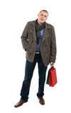 Young man holding shopping bags Royalty Free Stock Images