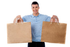 Young man holding shopping bags Royalty Free Stock Photos