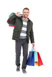 Young man holding shopping bags Royalty Free Stock Image