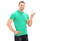 Young man holding a single roll of toilet paper Royalty Free Stock Images