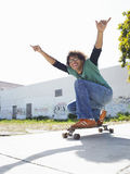 Young Man Holding Skateboard Royalty Free Stock Images