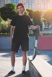 Young man holding skateboard. Stock Images