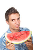 Young man holding a slice of watermelon Royalty Free Stock Photos