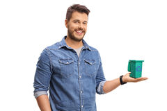 Young man holding a small recycling bin. Isolated on white background Stock Photo