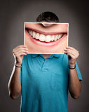 Young man holding a smile Royalty Free Stock Photography