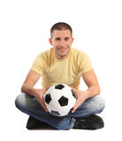 Young man holding a soccer ball Royalty Free Stock Photo
