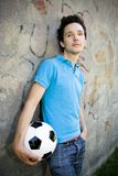 Young man holding soccer ball Royalty Free Stock Photos
