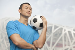 Young man holding soccer ball, Beijing Royalty Free Stock Image