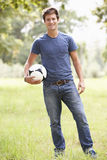 Young Man Holding Soccer Ball In Countryside Royalty Free Stock Photos