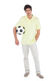 Young man holding soccer ball Stock Photos