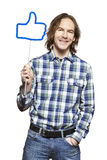 Young man holding a social media sign smiling Royalty Free Stock Photo
