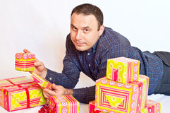 Young man holding some gifts. Young corporate man with gift boxes Stock Photo