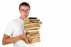 Young man  holding stack of books Royalty Free Stock Photo