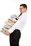 Young man holding stack of books Royalty Free Stock Photography