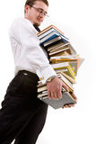 Young man holding stack of books Stock Photo