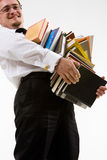 Young man holding stack of books Royalty Free Stock Images