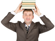 Young man holding stack of books Royalty Free Stock Photos