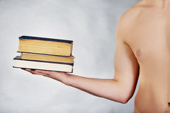 Young man holding stack of books. Stock Photography