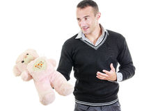 Young man holding stuffed teddy bear as a gift Stock Image