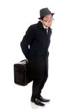 Young man holding suitcase isolated on white Royalty Free Stock Photography