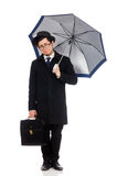 Young man holding suitcase and umbrella isolated Stock Image