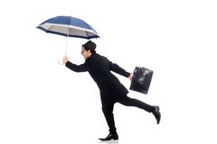 Young man holding suitcase and umbrella isolated Stock Photo
