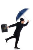 Young man holding suitcase and umbrella isolated Royalty Free Stock Photography