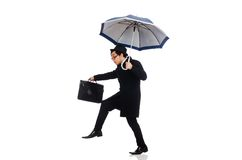 Young man holding suitcase and umbrella isolated Royalty Free Stock Photo