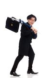 Young man holding suitcase and umbrella isolated Royalty Free Stock Images