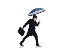 Young man holding suitcase and umbrella isolated Stock Photos